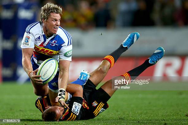 Jean De Villiers of the Stormers is tackled by Aaron Cruden of the Chiefs during the round five Super Rugby match between the Chiefs and the Stormers...