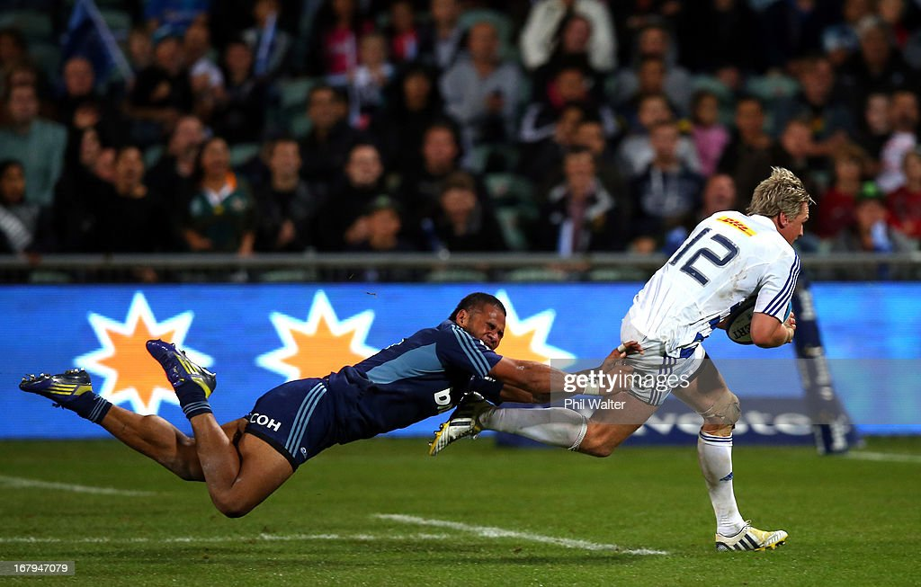 Jean De Villiers of the Stormers scores a try in the tackle of Frank Halai of the Blues during the round 12 Super Rugby match between the Blues and the Stormers at North Harbour Stadium on May 3, 2013 in Auckland, New Zealand.