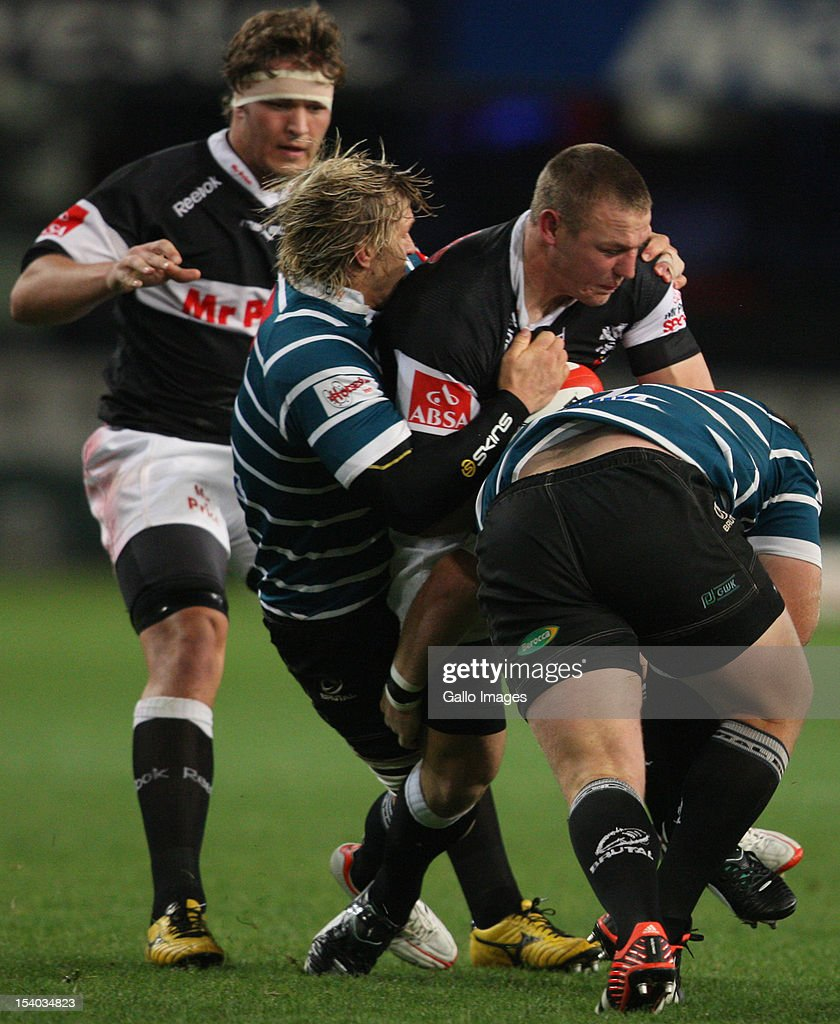 Jean Deysel is held by Justin Downey during the Absa Currie Cup match between The Sharks and GWK Griquas at Mr Price KINGS PARK on October 12, 2012 in Durban, South Africa.