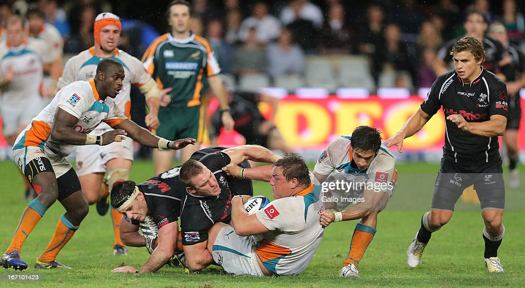 Jean Deysel tackling Coenie Oosthuizen during the Super Rugby match between The Sharks and Toyota Cheetahs from Kings Park on April 20, 2013 in Durban, South Africa.