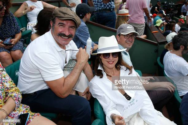 Jean Dujardin and Elsa Zylberstein attend the Men Final of the 2017 French Tennis Open Day Fithteen at Roland Garros on June 11 2017 in Paris France
