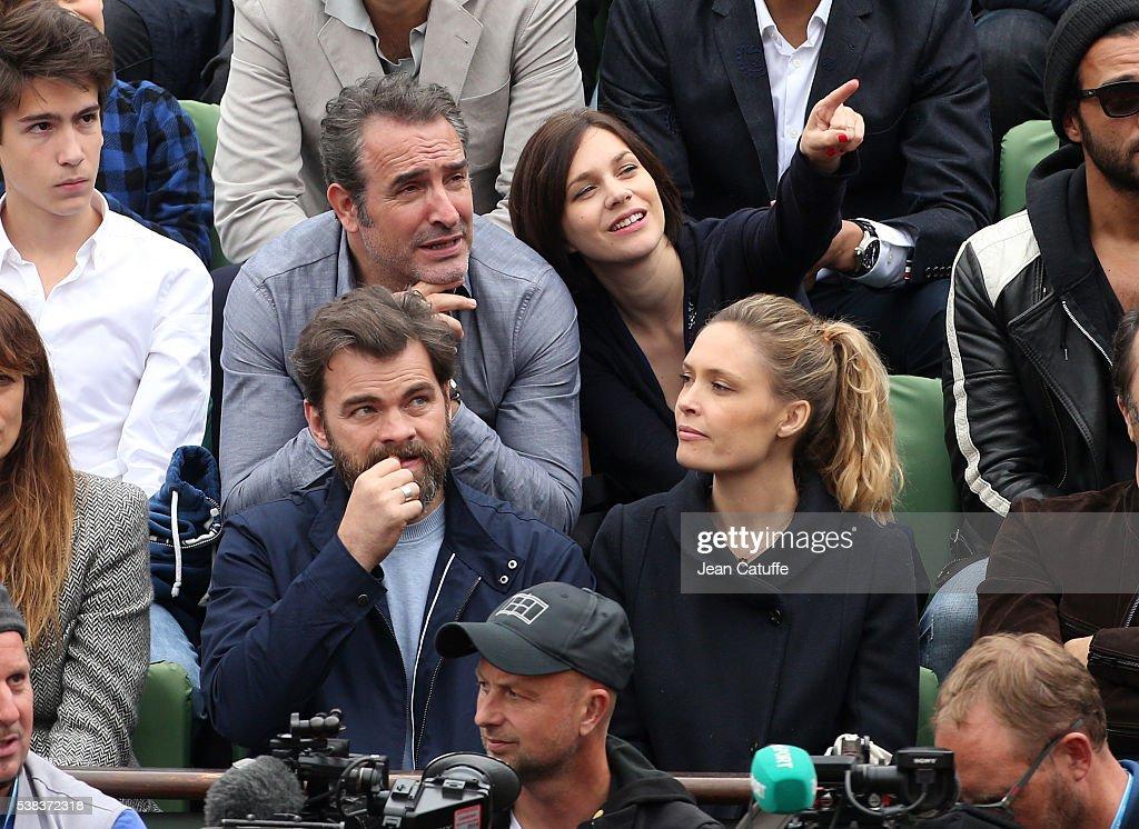 Jean Dujardin and his partner Nathalie Pechalat below them Clovis Cornillac and his wife Lilou Fogli attend the Men's Singles final between Novak...
