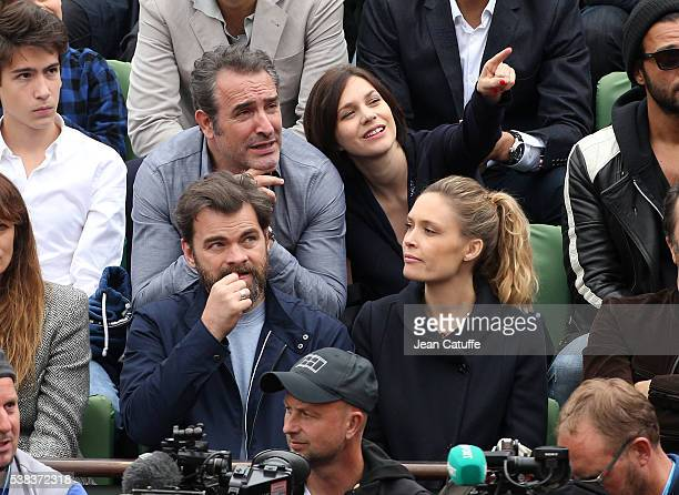 Jean Dujardin and his partner Nathalie Pechalat below them Clovis Cornillac and his wife Lilou Fogli attend the Men's Singles final between Novak...