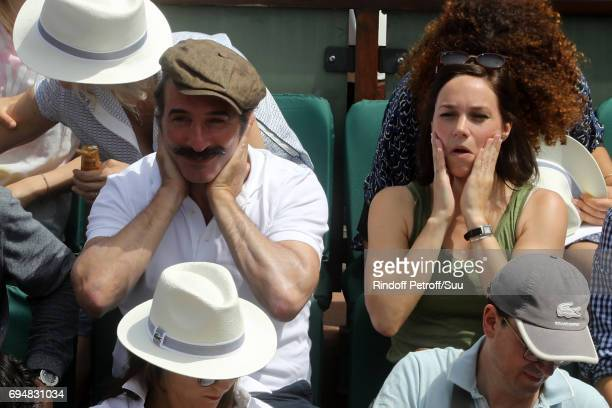 Jean Dujardin and Nathalie Pechalat are pictured inside Court Philippe Chatrier prior to the mens singles final match between Rafael Nadal of Spain...