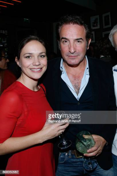 Jean Dujardin and Nathalie Pechalat attend Claude Lelouch celebrates his 80th Birthday at Restaurant Victoria on October 30 2017 in Paris France