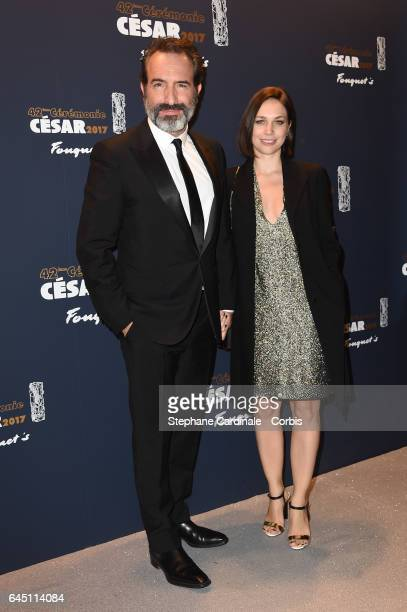 Jean Dujardin and Nathalie Pechalat attend the Cesar Dinner at Le Fouquet's on February 24 2017 in Paris France