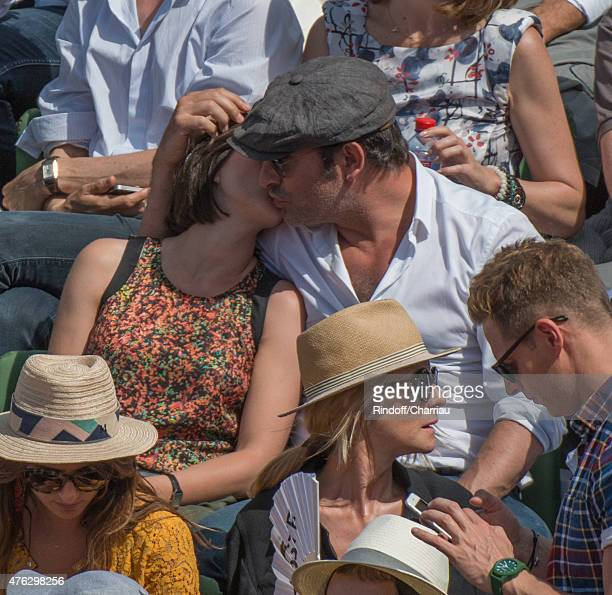 Jean Dujardin and Nathalie Pechalat attend the french open at Roland Garros on June 7 2015 in Paris France