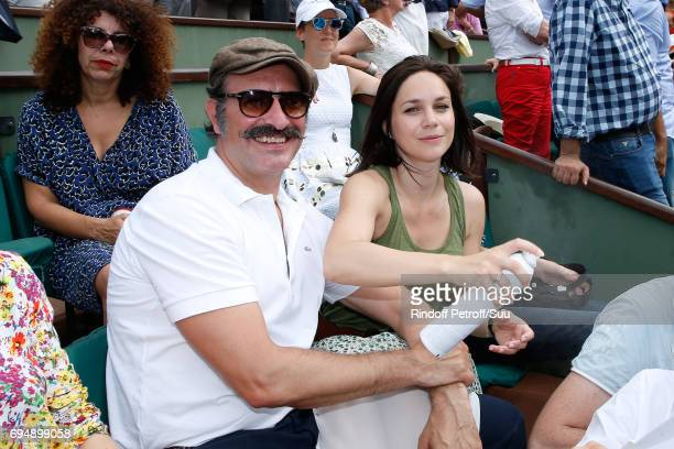 Jean Dujardin and Nathalie Pechalat attend the Men Final of the 2017 French Tennis Open Day Fithteen at Roland Garros on June 11 2017 in Paris France
