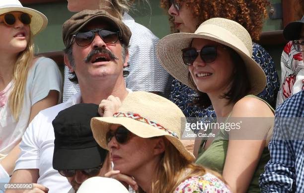 Jean Dujardin and Nathalie Pechalat attend the men's final on day 15 of the 2017 French Open second Grand Slam of the season at Roland Garros stadium...
