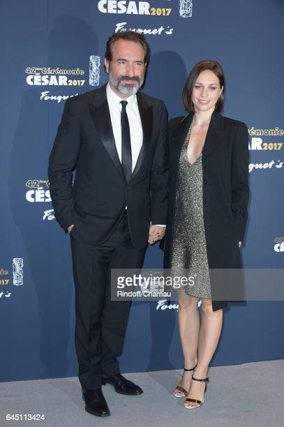 Jean Dujardin and Nathalie Pechalat attend the Red Carpet Arrivals during the Cesar Film Awards 2017 at Le Fouquet's on February 24 2017 in Paris...
