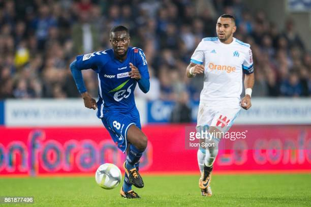 Jean Eudes Aholou of Strasbourg and Dimitri Payet of Marseille during the Ligue 1 match between Strasbourg and Olympique Marseille at Stade de la...