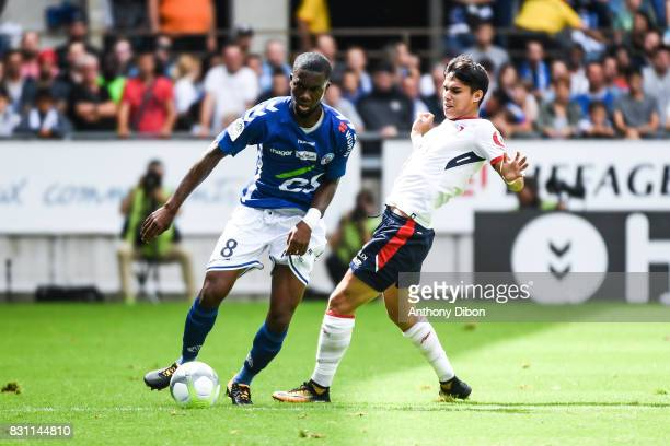 Jean Eudes Aholou of Strasbourg and Luiz De Araujo of Lille during the Ligue 1 match between Racing Club Strasbourg and Lille OSC at Stade de la...