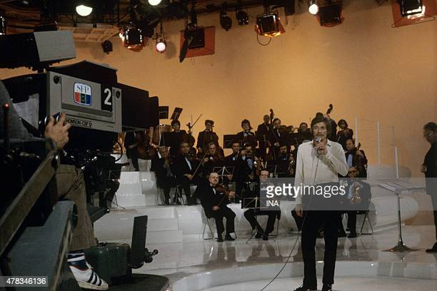 Jean Ferrat accompanied by the orchestra of Alain Goraguer sings on the set ''Ferrt 80''