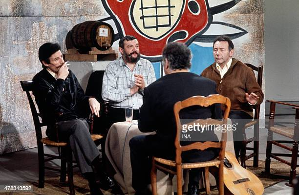 Jean Ferrat Jean Pierre Chabrol Francis Lemarque and Georges Brassens on the set ''L'invite du dimanche''