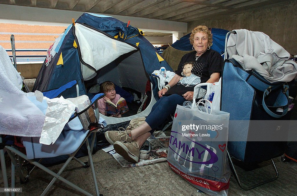 Jean Firth and Grand daughter Jesssica Matthews, fans of veteran singer Sir Cliff Richard, are seen in a make shift camp as they wait for tickets to be released for his forthcoming concert, June 3, 2005 in Birmingham, England. The campsite set up in the car park of the National Indoor Arena has become the unlikely area for the dedicated fan base to await the ticket sales for the singers final pro-celebrity tennis match released on Monday June 6.