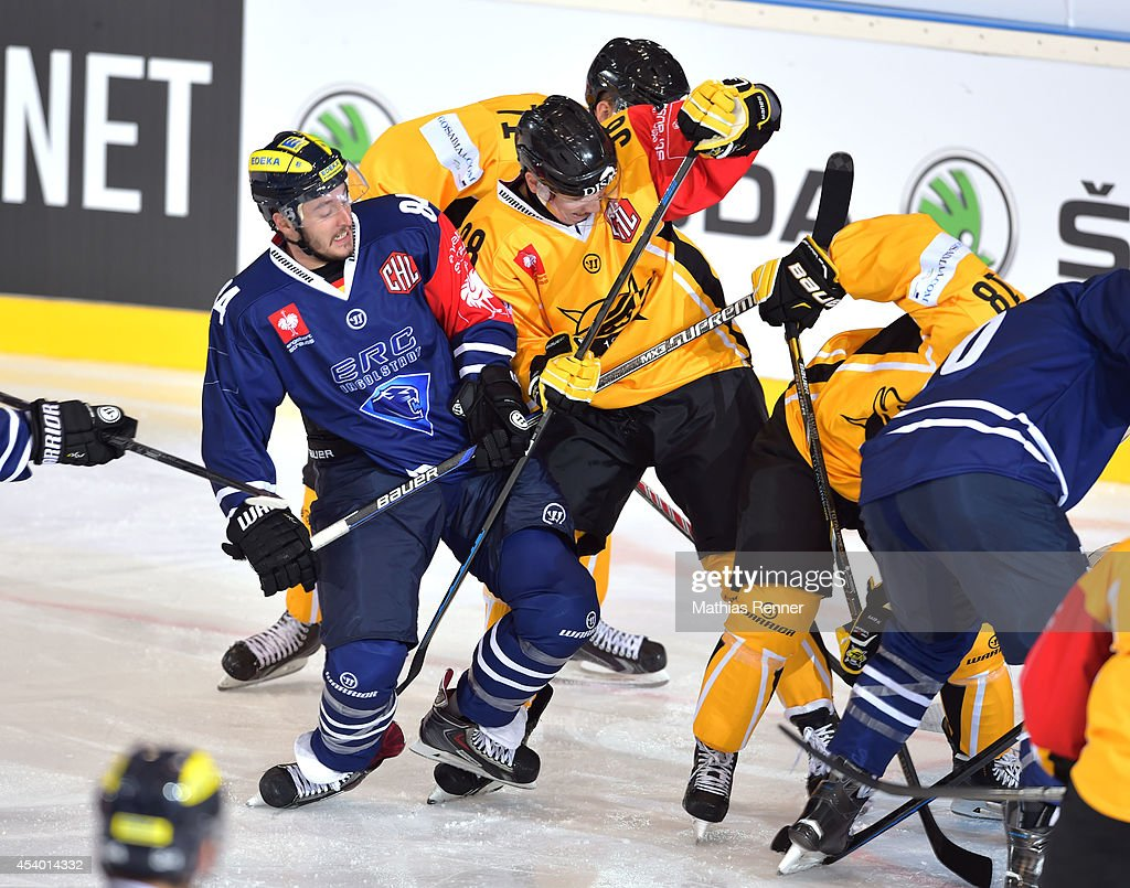 Jean Francois Boucher #84 of ERC Ingolstadt and Simo-Pekka Riikola fight for the puck during the Champions Hockey League group stage game between ERC Ingolstadt v SaiPa Lappeenranta on August 23, 2014 in Ingolstadt, Germany.