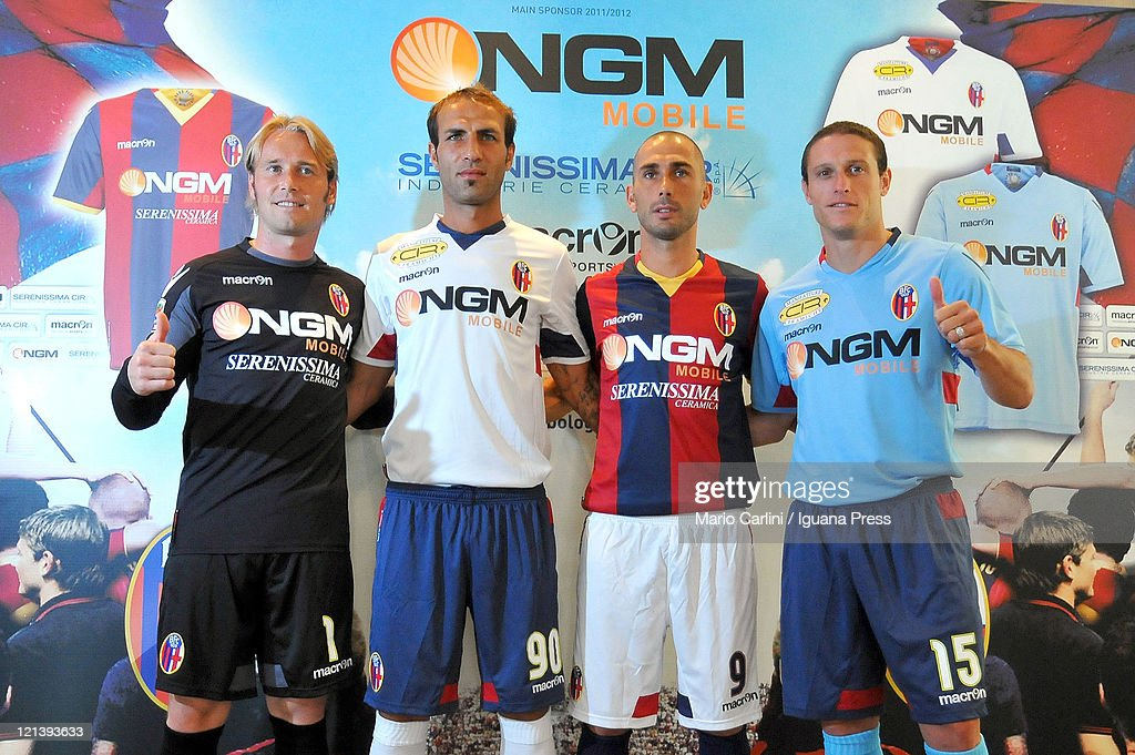 Jean Francois Gillet Daniele Portanova <a gi-track='captionPersonalityLinkClicked' href=/galleries/search?phrase=Marco+Di+Vaio&family=editorial&specificpeople=674311 ng-click='$event.stopPropagation()'>Marco Di Vaio</a> <a gi-track='captionPersonalityLinkClicked' href=/galleries/search?phrase=Diego+Perez&family=editorial&specificpeople=697338 ng-click='$event.stopPropagation()'>Diego Perez</a> players of Bologna FC stands with the new uniform during the press conference at the Savoia Regency Hotel on August 19, 2011 in Bologna, Italy.