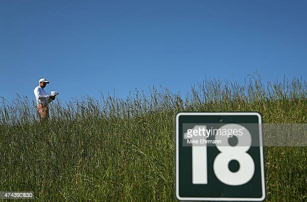 Jean Francois Remesy of France waits to hit his tee shot on the 18th hole during the second round of the Senior PGA Championship Presented By...