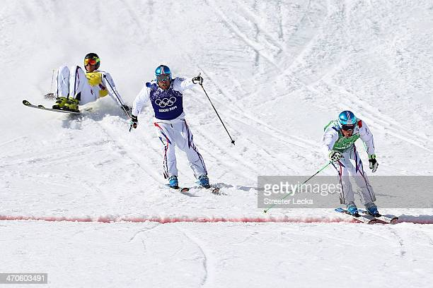 Jean Frederic Chapuis of France celebrates winning the gold medal followed by silver medallist Arnaud Bovolenta of France and bronze medallist...