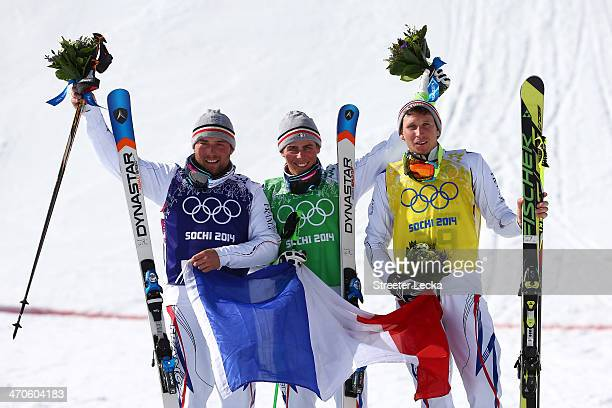 Jean Frederic Chapuis of France celebrates winning the gold medal with silver medallist Arnaud Bovolenta of France and bronze medallist Jonathan...