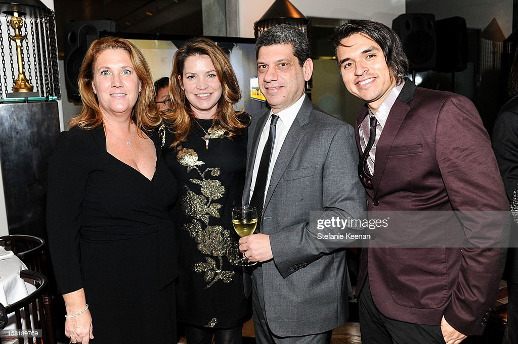 Jean Geresi, Jennifer Hawks, John Geresi and Edward Rodriguez attend LAXART Vision dinner At Mr. Chow sponsored by Jay Carlile and Guess at Mr. Chow on December 10, 2012 in Los Angeles, California.