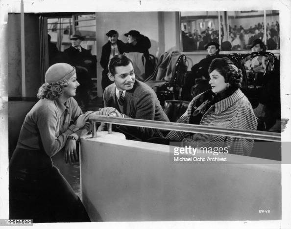 Jean Harlow Clark Gable and Myrna Loy sitting together in a scene from the film 'Wife vs Secretary' 1936