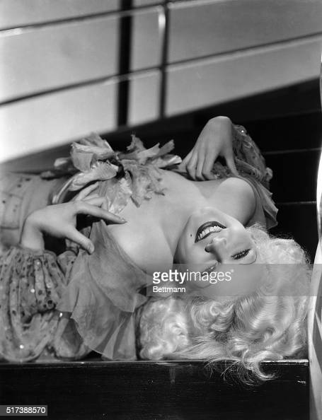 Jean Harlow in a glamour pose lying on her back Undated photograph