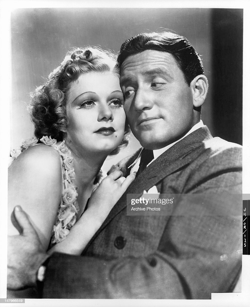 Jean Harlow leaning up on Spencer Tracy in a scene from the film 'Libeled Lady', 1936.