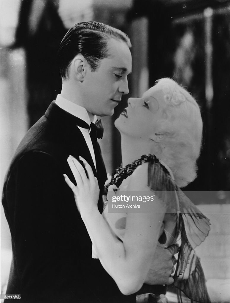 Jean Harlow (1911 - 1937) the stage name of Harlean Carpentier, the American leading lady, and Franchot Tone (1905 - 1968) the stage name of Stanislas Pascal Franchot Tone, the American leading man in close embrace in a scene from the 'Born To Be Kissed'. Title: Suzy Alternative Title: Born To Be Kissed Studio: MGM Director: George Fitzmaurice