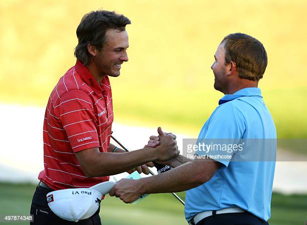 Jean Hugo of South Africa congratulates Chris Hanson of England after they both secure their tour cards during the final round of the European Tour...