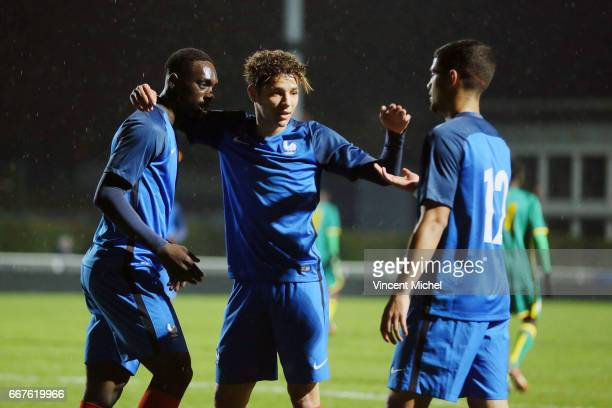 Jean Kevin Augustin Amine Harit and Ludovic Blas of France celebrate the third goal during the friendly U20 match between France and Senegal on March...