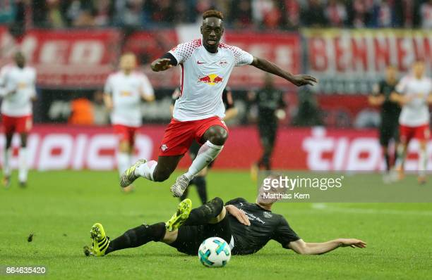 Jean Kevin Augustin of Leipzig battles for the ball with Dzenis Burnic of Stuttgart during the Bundesliga match between RB Leipzig and VfB Stuttgart...