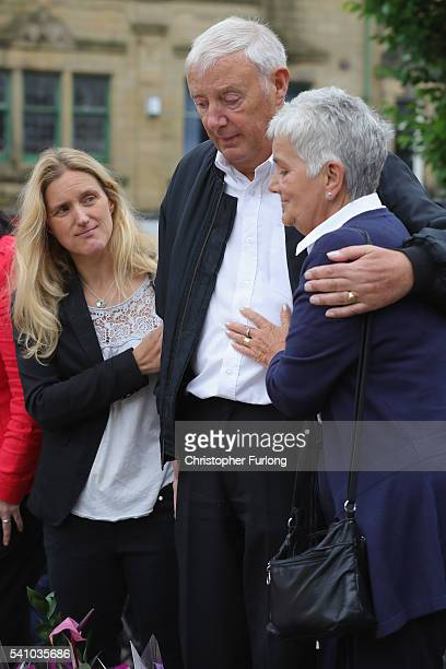 Jean Leadbeater the mother of Labour MP Jo Cox is embraced by her husband Gordon as her sister Kim Leadbeate looks on during their visit to see the...