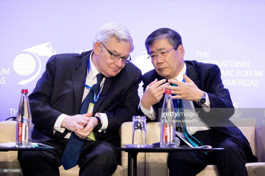 Jean Lemierre Chairman, BNP Paribas Group speaks with Shunichi Miyanaga President and CEO, Mitsubishi Heavy Industries as they attend the first edition of the Conference of Paris of the International Economic Forum of the Americas, in Paris, on December 7, 2017 in Paris, France. IEFA organizes annual summits bringing together heads of states, central bank governors, ministers and global economic decision makers. This annual meeting focus on providing a better understanding of the major challenges facing the global economy, with particular attention to relations between Europe and other continents