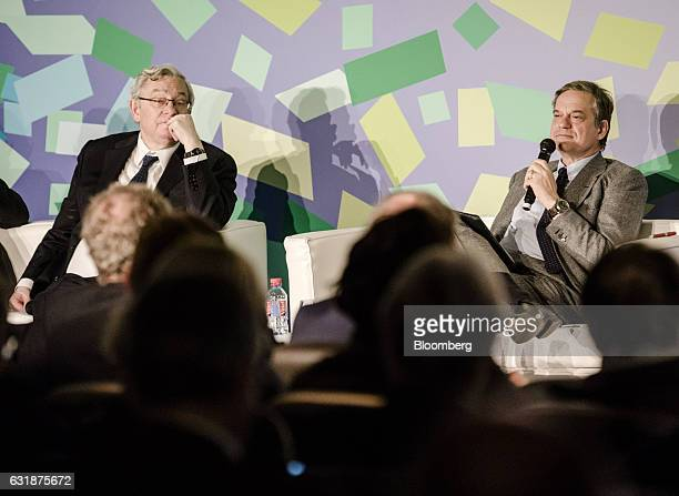 Jean Lemierre chairman of BNP Paribas SA left looks on as he sits on stage with Lorenzo Bini Smaghi chairman of Societe Generale SA during the...