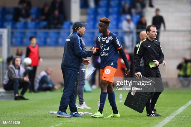 Jean Louis Gasset Coach and Isaac Mbenza of Montpellier during the French Ligue 1 match between Montpellier and Toulouse at Stade de la Mosson on...