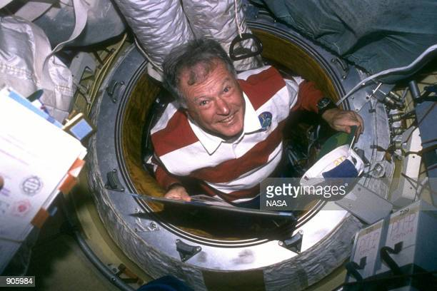 Jean Loup J M Chretien mission specialist representing the French Space Agency floats into the Core Module of Russia's Mir Space Station prior to a...