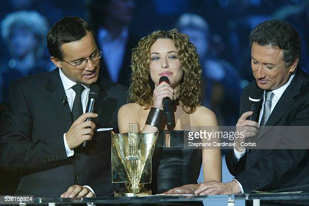 Jean Luc Delarue Natasha St Pier and Michel Drucker attend the 2003 French Music Awards in Paris St Pier won the Best New Artist of the Year award
