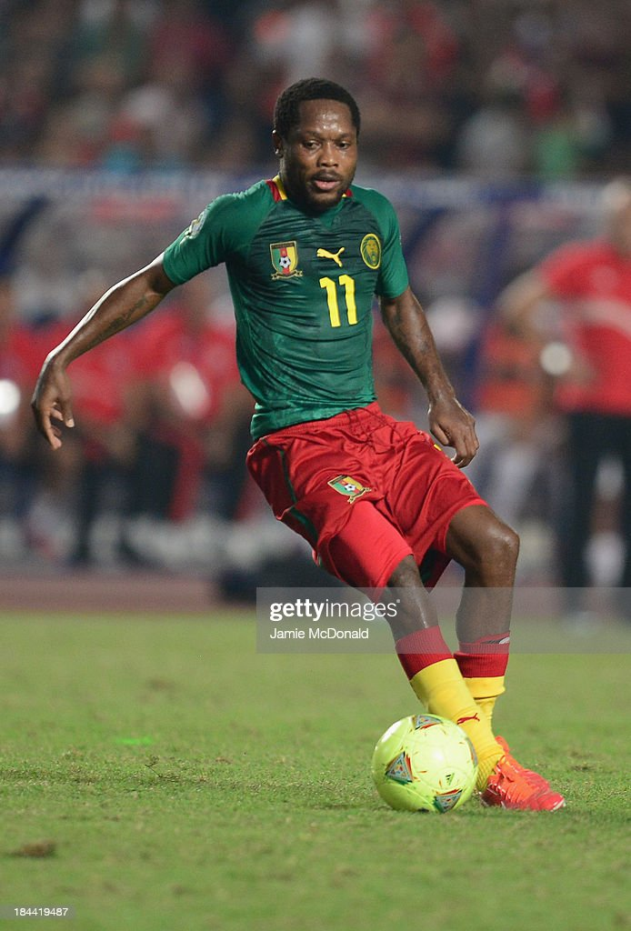 <a gi-track='captionPersonalityLinkClicked' href=/galleries/search?phrase=Jean+Makoun&family=editorial&specificpeople=807728 ng-click='$event.stopPropagation()'>Jean Makoun</a> of Cameroon in action during the FIFA 2014 World Cup qualifier at the Stade Olympique de Radès on October 13, 2013 in Rades, Tunisia.