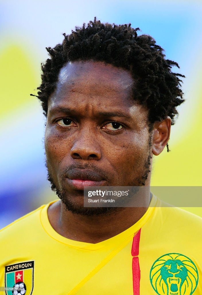 <a gi-track='captionPersonalityLinkClicked' href=/galleries/search?phrase=Jean+Makoun&family=editorial&specificpeople=807728 ng-click='$event.stopPropagation()'>Jean Makoun</a> of Cameroon lines up for the national anthems prior to the 2010 FIFA World Cup South Africa Group E match between Japan and Cameroon at the Free State Stadium on June 14, 2010 in Mangaung/Bloemfontein, South Africa.