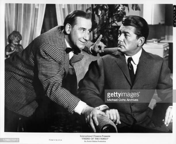 Jean Marais with Pierre Dux in a tuxedo in a scene from the film 'Friend Of The Family' 1964