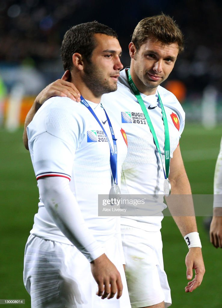 Jean Marc Doussain of France (L) is comforted by his teammate <a gi-track='captionPersonalityLinkClicked' href=/galleries/search?phrase=Vincent+Clerc&family=editorial&specificpeople=235795 ng-click='$event.stopPropagation()'>Vincent Clerc</a> after losing 8-7 in the 2011 IRB Rugby World Cup Final match between France and New Zealand at Eden Park on October 23, 2011 in Auckland, New Zealand.