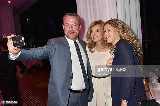 Jean Marie Guibert Valerie Trierweiler and Tassa Benech pose for a selfie during 22th Amnesty International France Gala at Theatre des Champs Elysees...