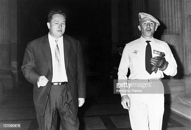 Jean Marie Le Pen and Colonel Fourcade come to court as witnesses on July 9 1962 in Paris France