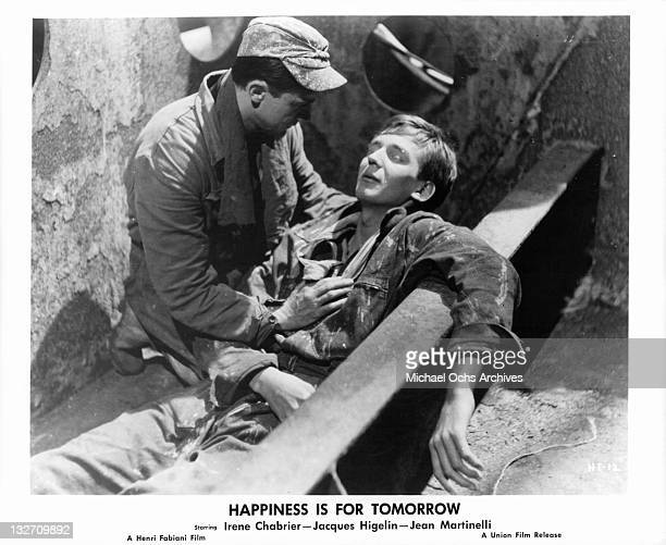 Jean Martinelli holding Jacques Higelin in a scene from the film 'Happiness Is For Tomorrow' 1961