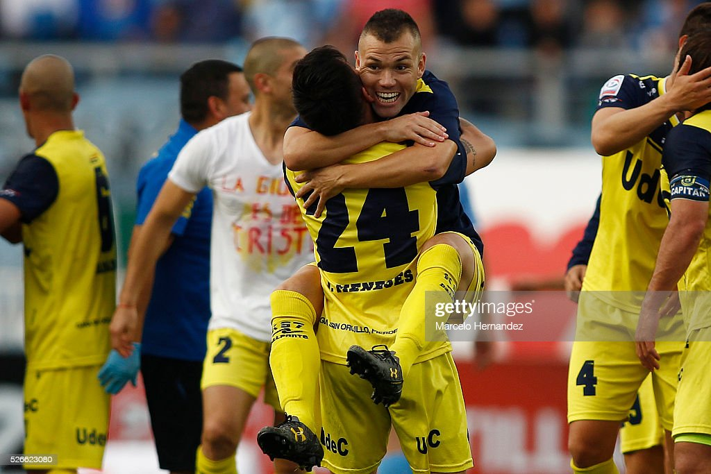Jean Meneses of Universidad de Concepcion celebrates with his teammate after winning a match against O'Higgins as part of Torneo Clausura 2016 at El Teniente Stadium on April 30, 2016 in Rancagua, Chile.