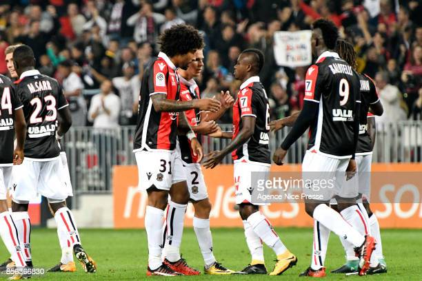 Jean Michael Seri celebrates with team mates during the Ligue 1 match between OGC Nice and Olympique Marseille at Allianz Riviera on October 1 2017...