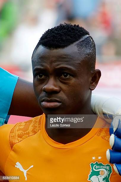 Jean Michael Seri of Ivory Coast listens to the anthem during the International Friendly match between Hungary and Ivory Coast at Groupama Arena on...