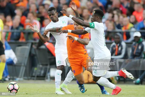 Jean Michael Seri of Ivory Coast Memphis Depay of Holland Serge Aurier of Ivory Coastduring the friendly match between The Netherlands and Ivory...