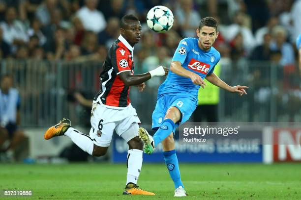 Jean Michael Seri of Nice and Jorginho of Napoli during the UEFA Champions League Qualifying PlayOffs round second leg match between OGC Nice and SSC...